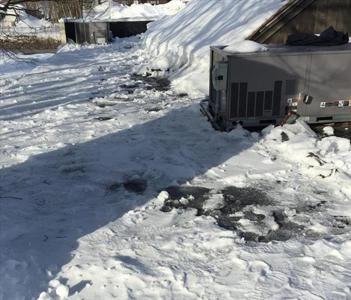 Too much snow around and AC unit on roof causing a leak