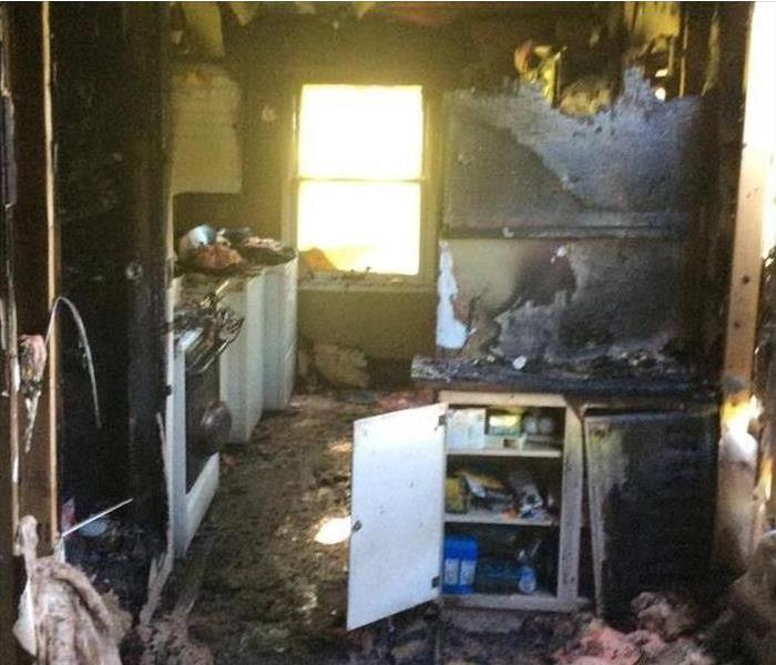 Aftermath of a fire in a house kitchen